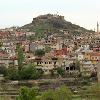 The outskirts of the modern city of Nevsehir, with Nevsehir Castle in the distance