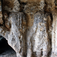 Soğmatar cave-temple with large figures and inscriptions carved in the walls.